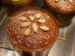 glazed panettone with almonds and pearl sugar before baking