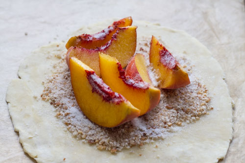 peach galette construction with breadcrumbs