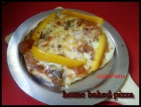 home baked pizza topped with capsicum and cheese