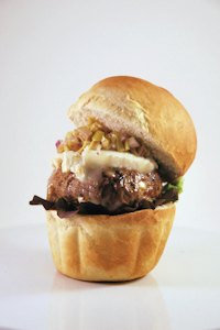 Hamburger with lamb, goat cheese and olive relish