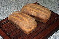 Sourdough Brown Loaf On Bricks