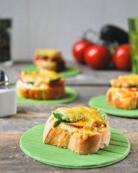 Crostini with tomato, avocado and cheese