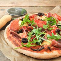 Pizza With Ham, Arugula And Olives