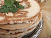 Kobzat al feta wal basal (Feta stuffed bread)
